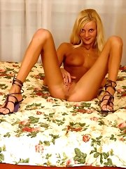 Sexy blonde virgin spreads on a bed